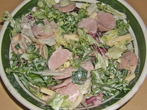 swiss sausage salad with greens and cheese